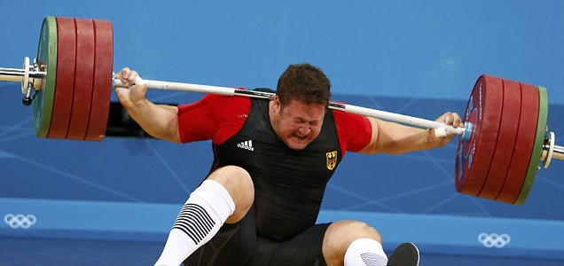 Matthias Steiner drops weight on his back after a failed lift.